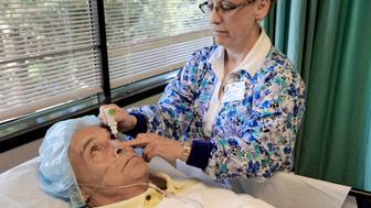 Senior patient is being prepared for cataract eye surgery