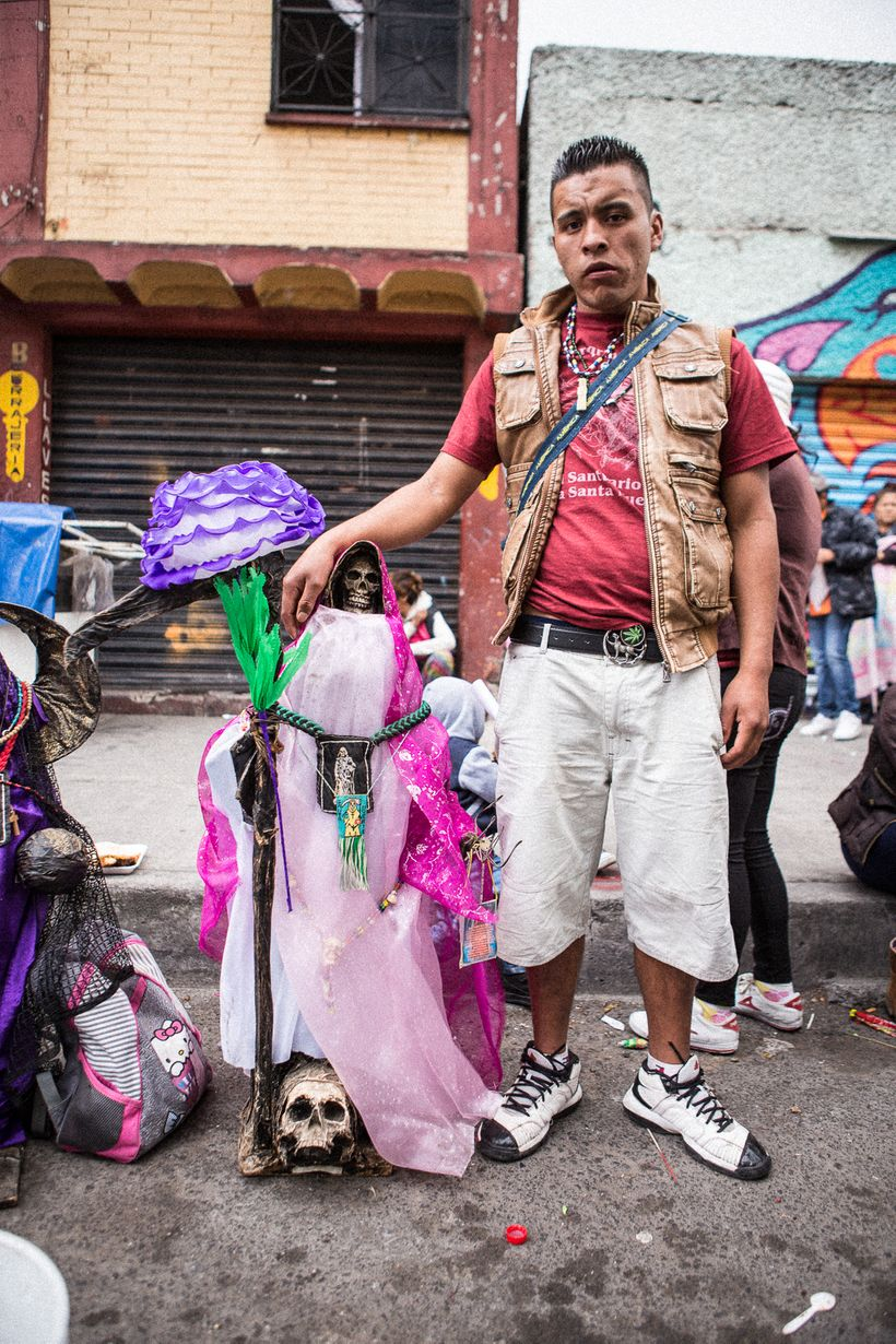 A devotee who brought his artisanal Santa Muerte to the Tepito shrine for blessing