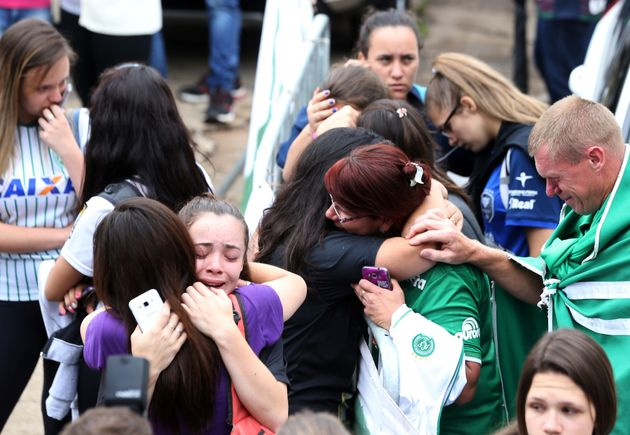 Fans of Chapecoense soccer team react in front of the Arena Conda stadium in Chapeco, Brazil, November...