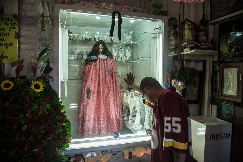 A devotee praying at the Santa Muerte shrine in Tepito