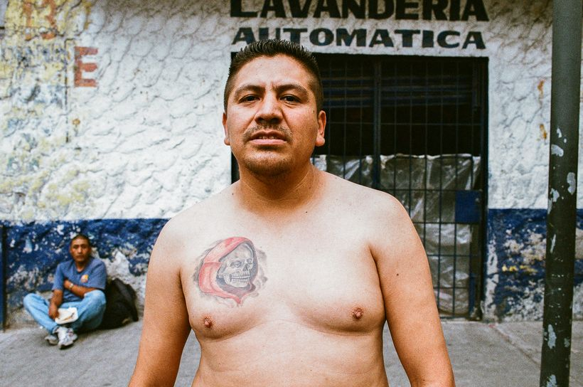 A devotee with Santa Muerte tattooed on his chest at the shrine in Tepito