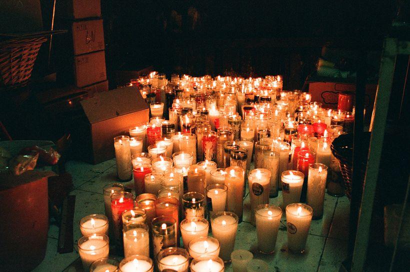 Votive candles at the Santa Muerte shrine in Tepito