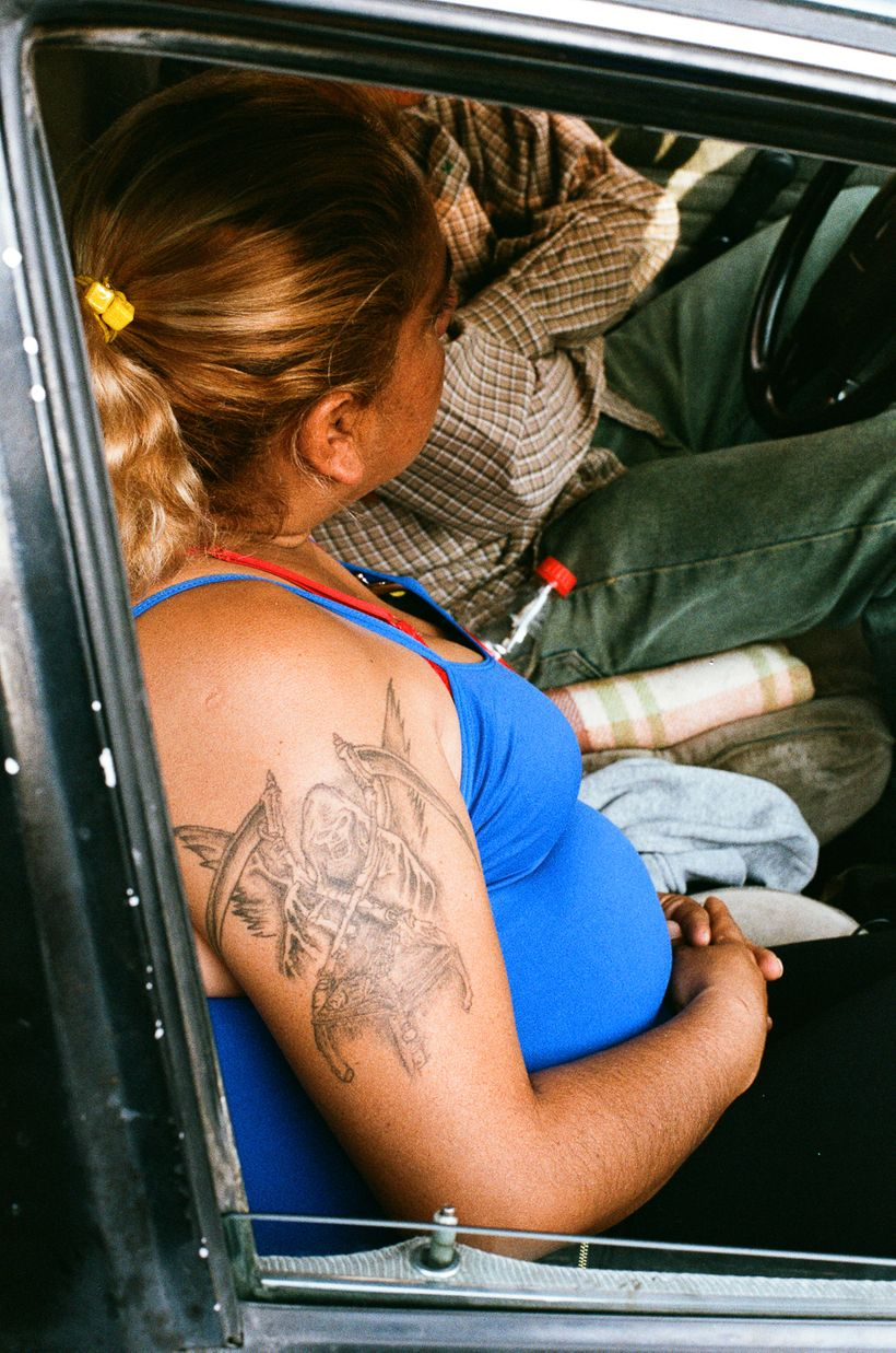 A devotee with the Bony Lady tattooed on her arm near the Santa Muerte shrine in Tepito