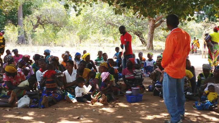 Volunteers with Malaria Consortium's pilot program leading a community dialogue in Nampula.
