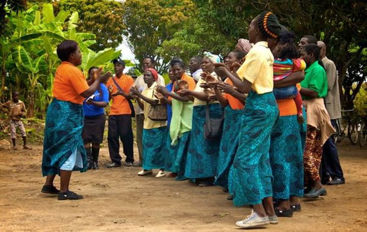 <p>Community volunteers greet visitors at an Early Childhood Development Center in Zambia</p>