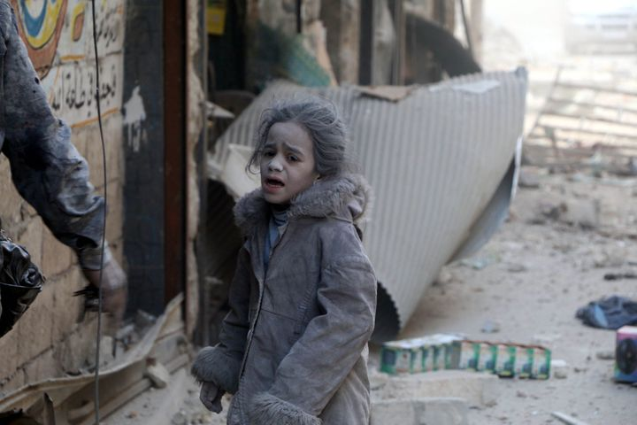 A Syrian child girl is seen at the scene of the air strikes carried out by the war crafts belonging to Russia and Assad regim