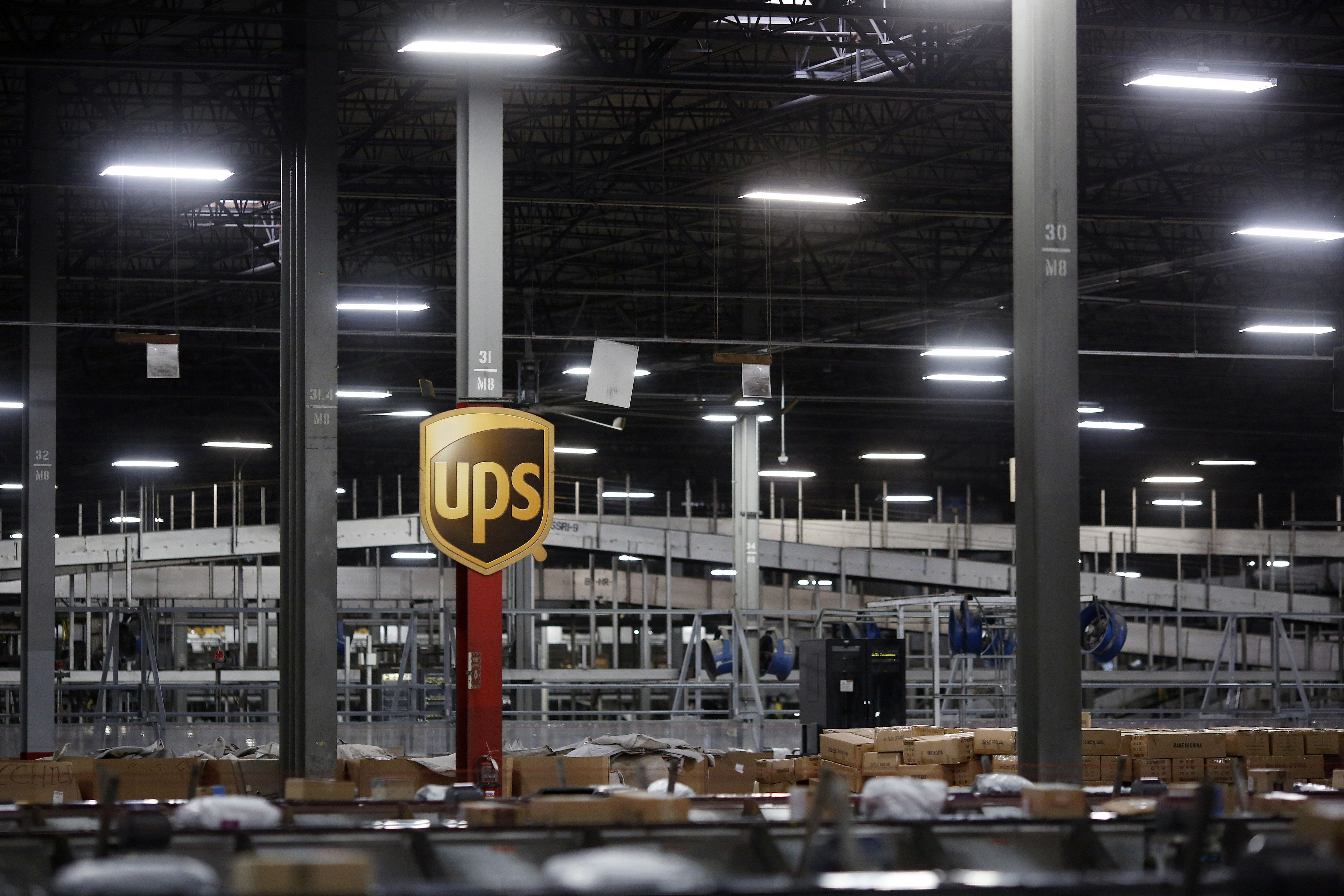 Packages move along conveyor belts at the United Parcel Service Inc. (UPS) Chicago Area Consolidation Hub (CACH) facility in Hodgkins, Illinois, U.S., on Monday, Nov. 28, 2016. Online stores are counting on shoppers to spend big during the 'Cyber Five' period from Thanksgiving to Cyber Monday to make up for time spent earlier this month obsessing about the presidential election instead. Photographer: Luke Sharrett/Bloomberg via Getty Images