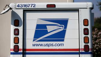 SAN FRANCISCO, CA - FEBRUARY 18:  A U.S. Postal Service mail truck sits in a parking lot at a mail distribution center on February 18, 2015 in San Francisco, California.  The Postal Service is looking to replace their aging fleet of mail delivery vehicles as their current trucks are becoming too small to meet the needs of their growing package delivery from large e-commerce vendors.  (Photo by Justin Sullivan/Getty Images)