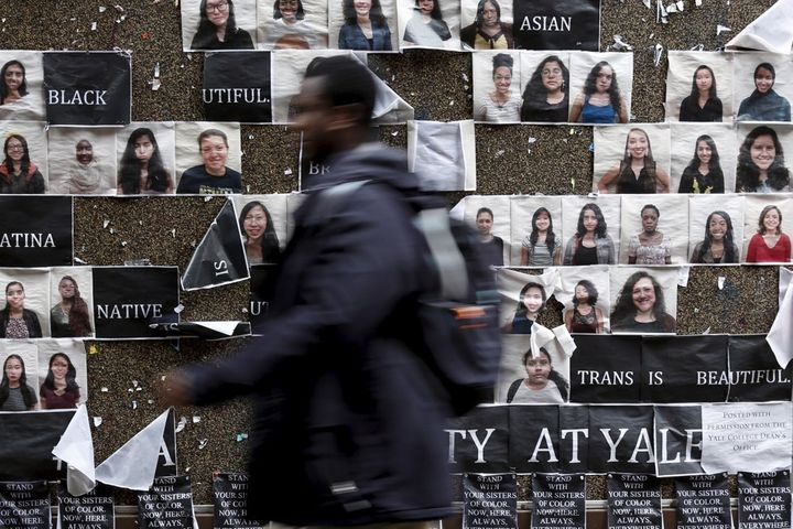 Yale student walks past a college noticeboard, prior to a college-wide discussion on race and diversity.
