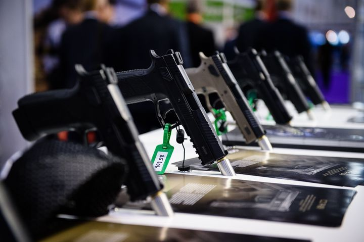 Pistols made by weapons manufacturer CZ sit on display inside the ExCeL centre in London on September 15, 2015, during the De
