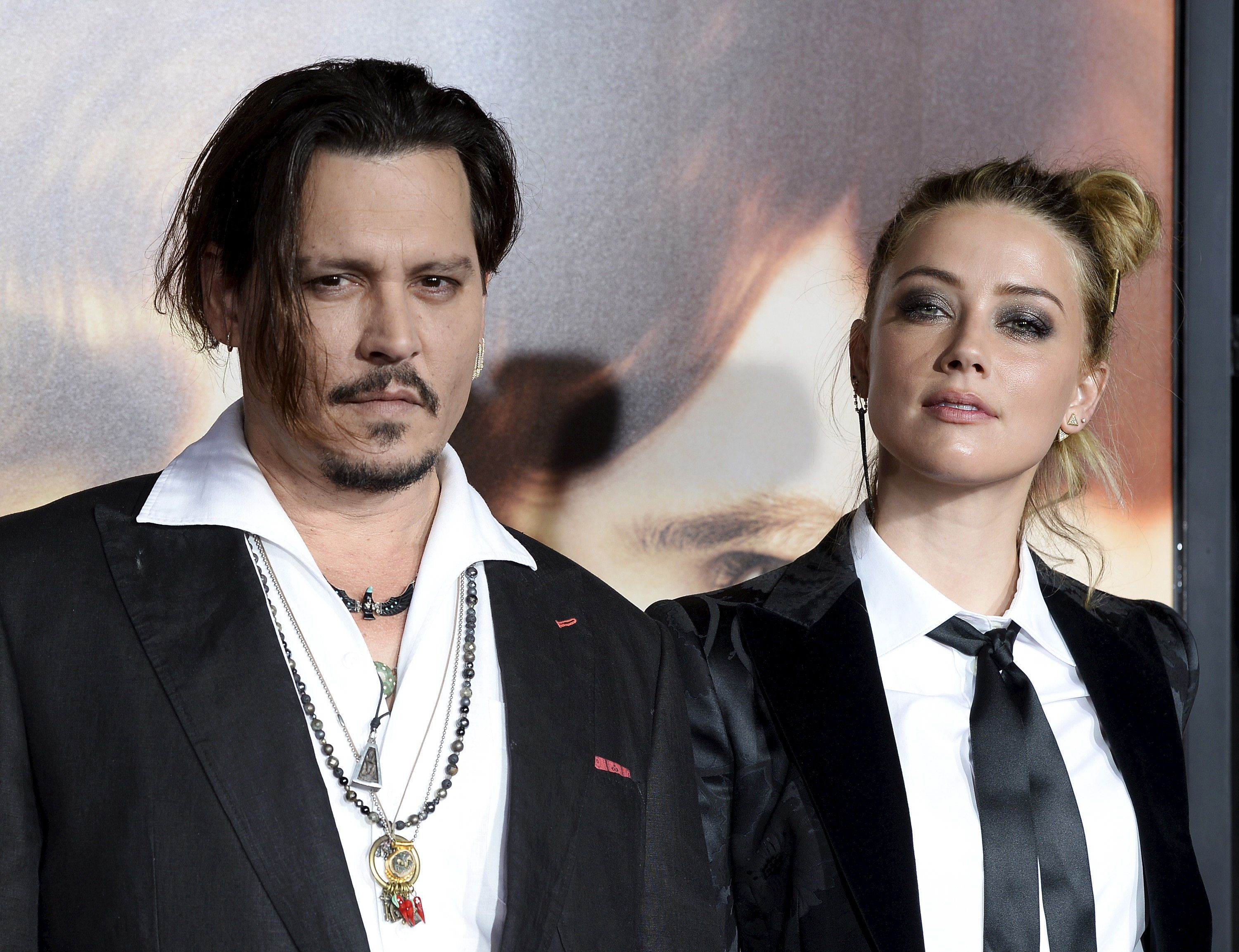 "Actor Johnny Depp and his wife Amber Heard, who is a cast member of the film ""The Danish Girl,"" pose during the premiere of the film in Los Angeles, California November 21, 2015. The film opens in the U.S. on November 27. REUTERS/Kevork Djansezian"