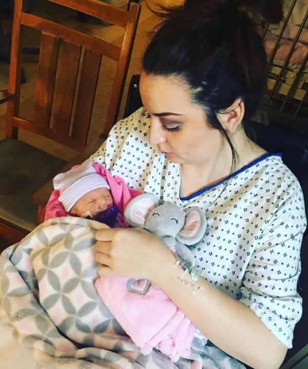 """""""This is the first time being able to hold my daughter, almost 30 hours after having her. I was induced at 36 weeks due to pr"""