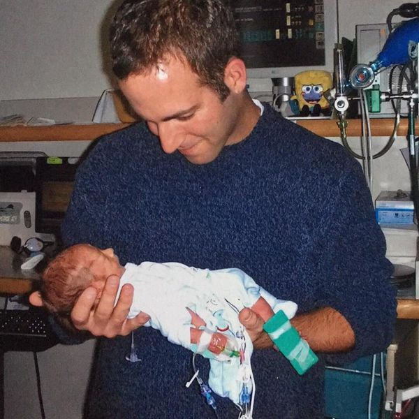 """""""My husband, Jeff Nordquist, holding our son Miles for the first time. He was under three poundsat birth and this was f"""