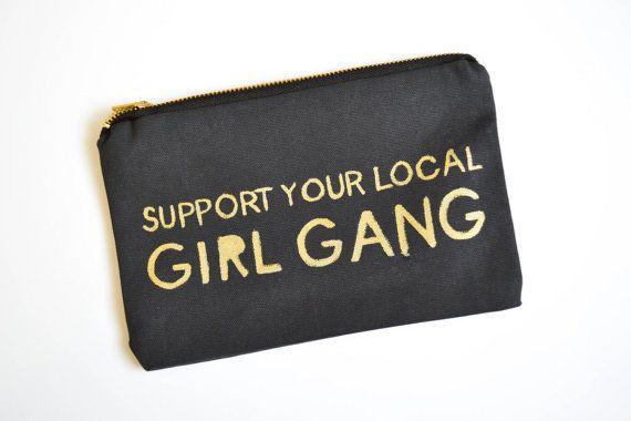 """$38, Etsy. <a href=""""https://www.etsy.com/listing/259323110/girl-power-clutch-feminist-bag-girl-gang?ref=market"""" target=""""_blan"""