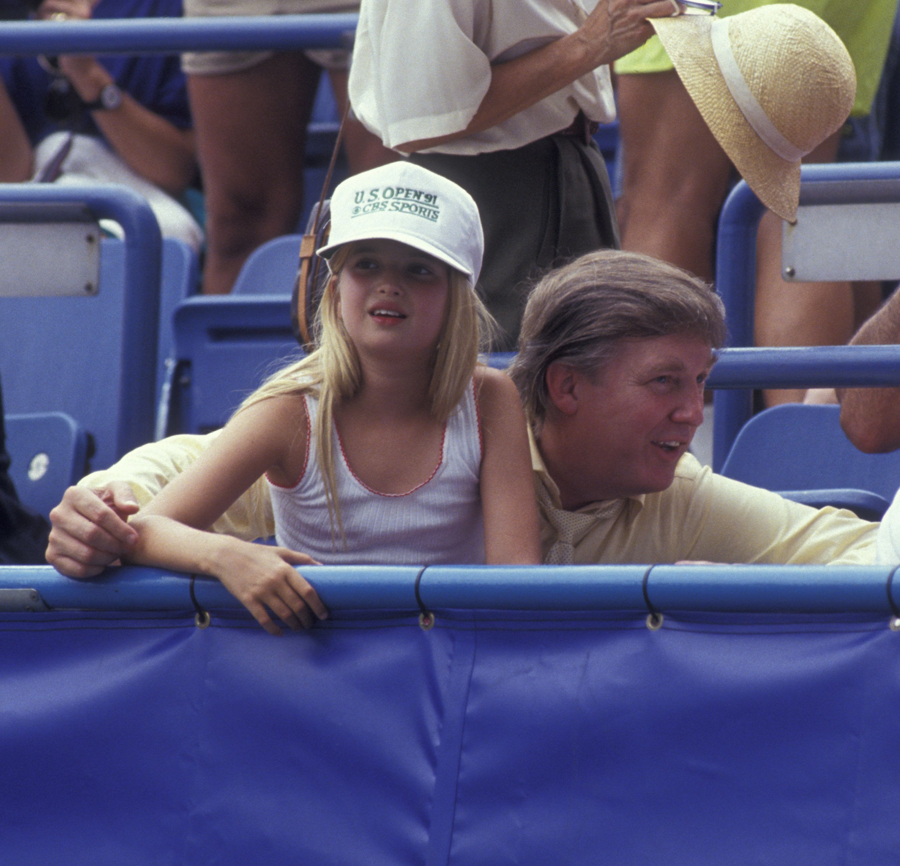 A young Ivanka Trump sits with her father back in1991.