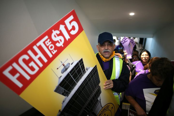 Workers nationwide advocated for a minimum wage of $15 an hour Tuesday, including this group at Los Angeles International Air