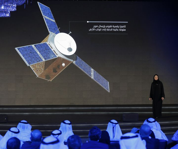 Sarah Amiri, deputy project manager of the United Arab Emirates (UAE) Mars Mission, stands on stage during a ceremony to unve