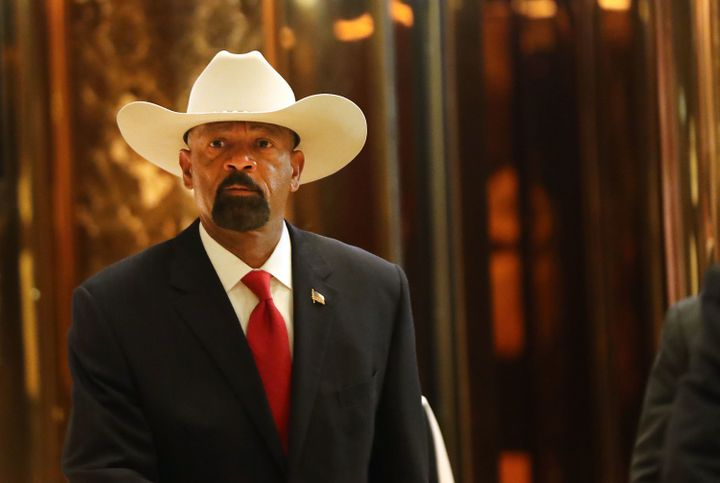 Milwaukee County Sheriff David Clarke leaves Trump Tower on Monday. Clarke is reportedly in the running to lead the Departmen