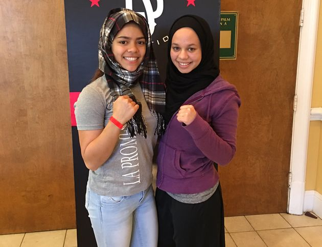 Aliyah Charbonier (left) wears a scarf to show solidarity with Amaiya