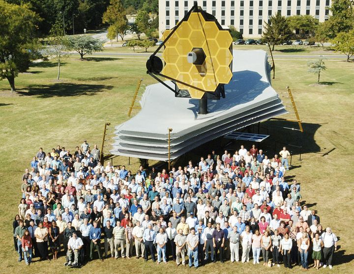 Team members with full-scale model of the Webb Telescope at Goddard Space Flight Center in Maryland.