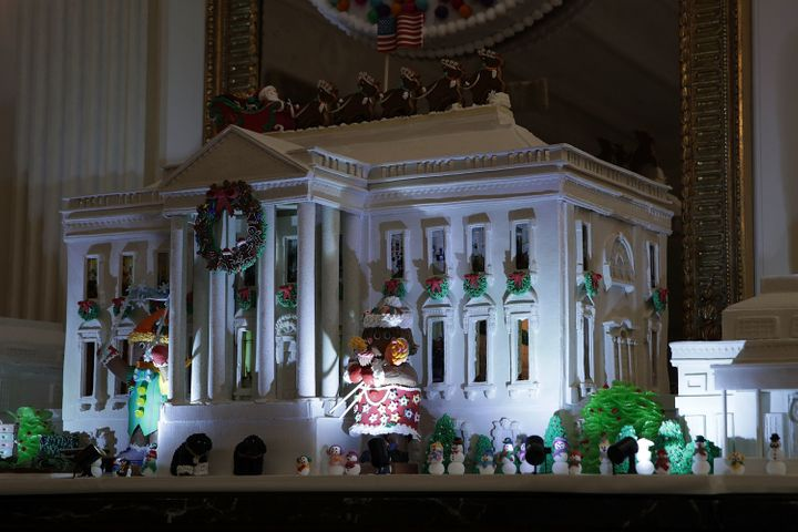 The White House Gingerbread House sits in the State Dining Room.