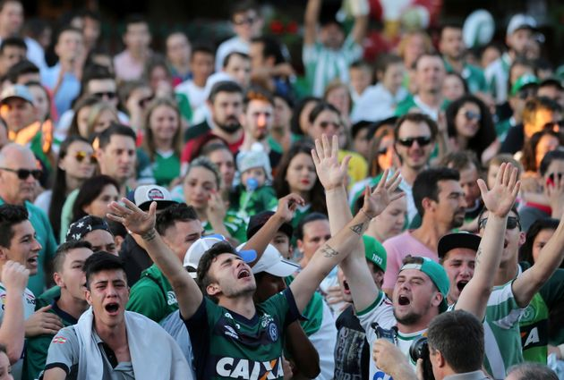 Fans of Chapecoense soccer team gather in the streets to pay tribute to their players in Chapeco,