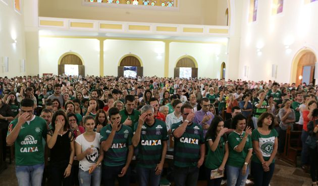 Fans attend a mass at the Santo Antonio Cathedral in Chapeco,