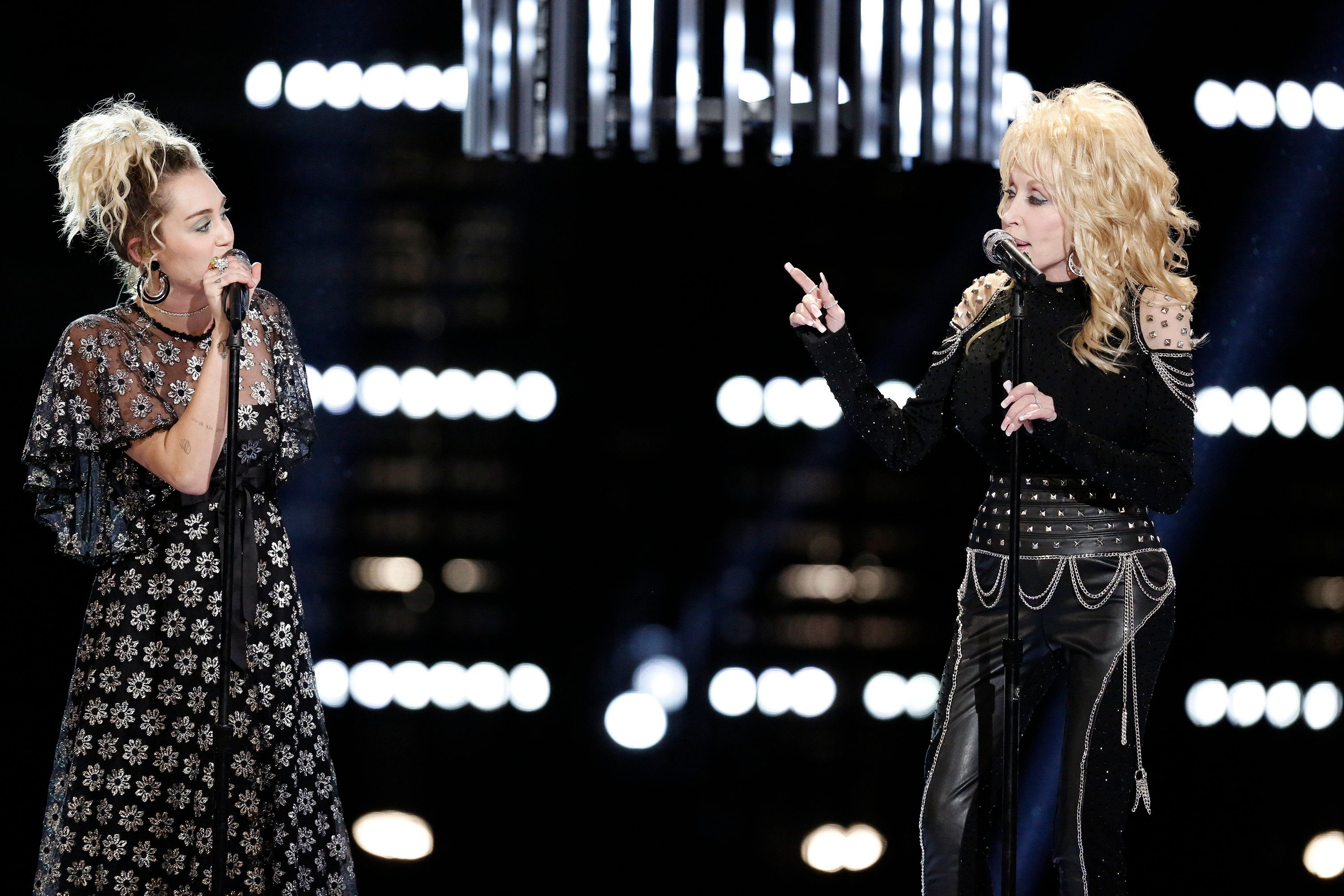 THE VOICE -- 'Live Top 10' Episode 1116B -- Pictured: (l-r) Miley Cyrus, Dolly Parton -- (Photo by: Tyler Golden/NBC/NBCU Photo Bank via Getty Images)