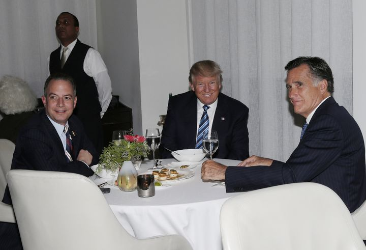 Mitt Romney gets cozy with Reince Priebus and President-elect Donald Trump at dinner Tuesday night.