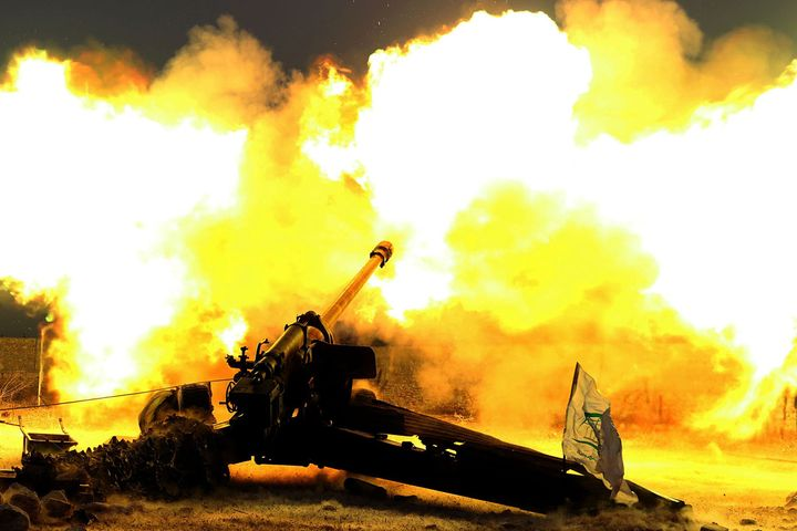 Syrian opposition members fire artillery as they attack the Assad regime forces in Kafr Hamrah village of Aleppo, Syria on No