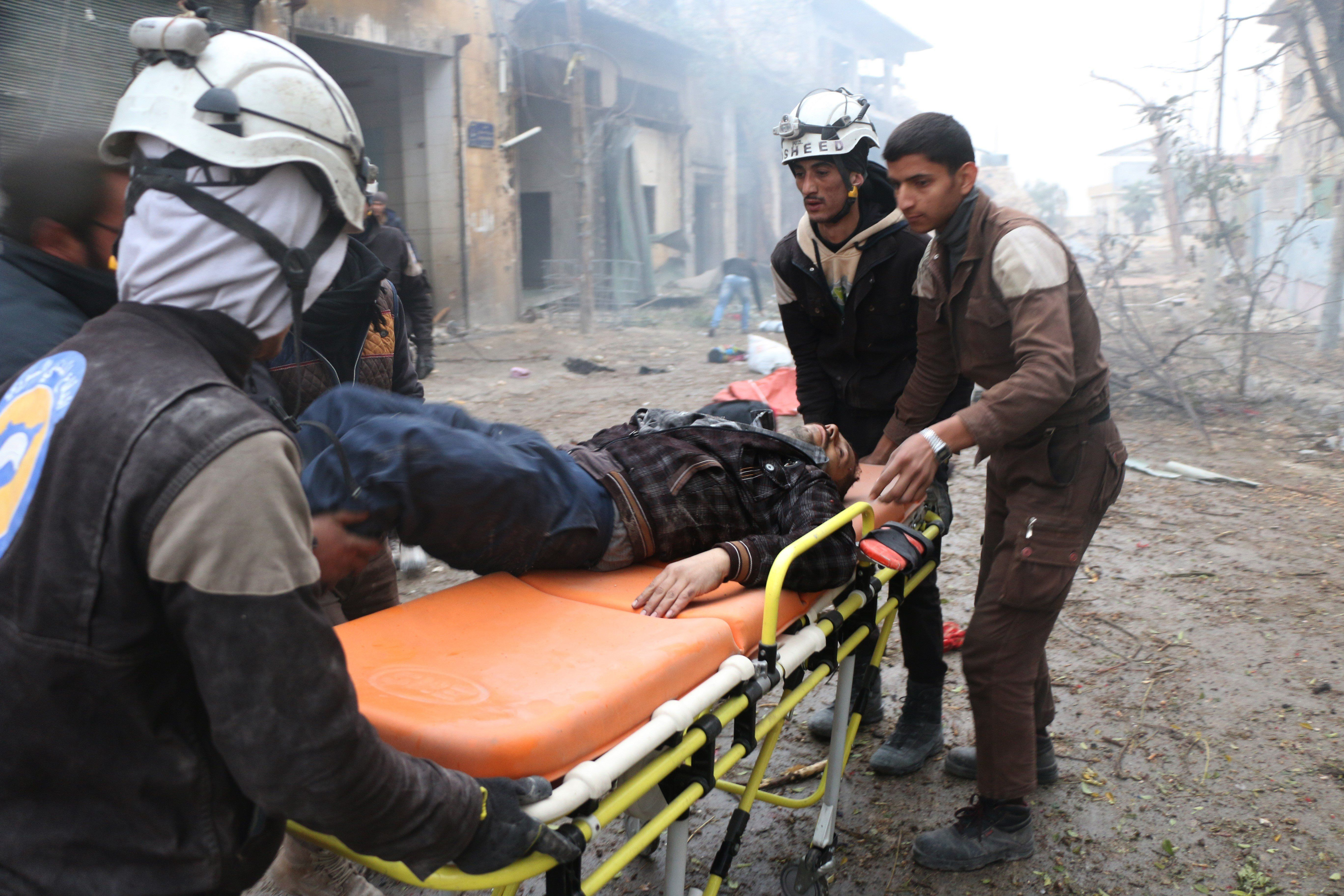 ALEPPO, SYRIA - NOVEMBER 30: Search and rescue team members hospitalize a wounded civilian at the site of blast after Assad Regime's strike over civilians in residential areas of Jub Al Quba neighborhood of Aleppo, Syria on November 30, 2016. At least 45 civilians including children and women, killed during the attack. (Photo by Jawad al Rifai/Anadolu Agency/Getty Images)
