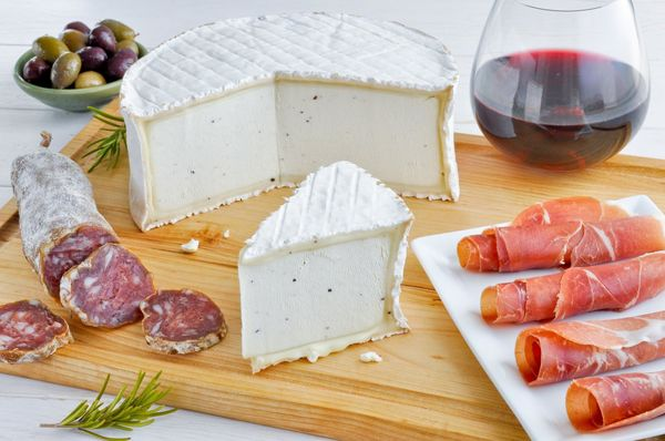 """<a href=""""http://www.cypressgrovecheese.com/cheese/soft-ripened-cheeses/truffle-tremor.html"""" target=""""_blank"""">Truffle Tremor&nb"""