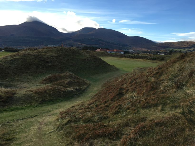 The walk down to the fairway after a blind tee shot on the unforgettable ninth hole at Royal County Down
