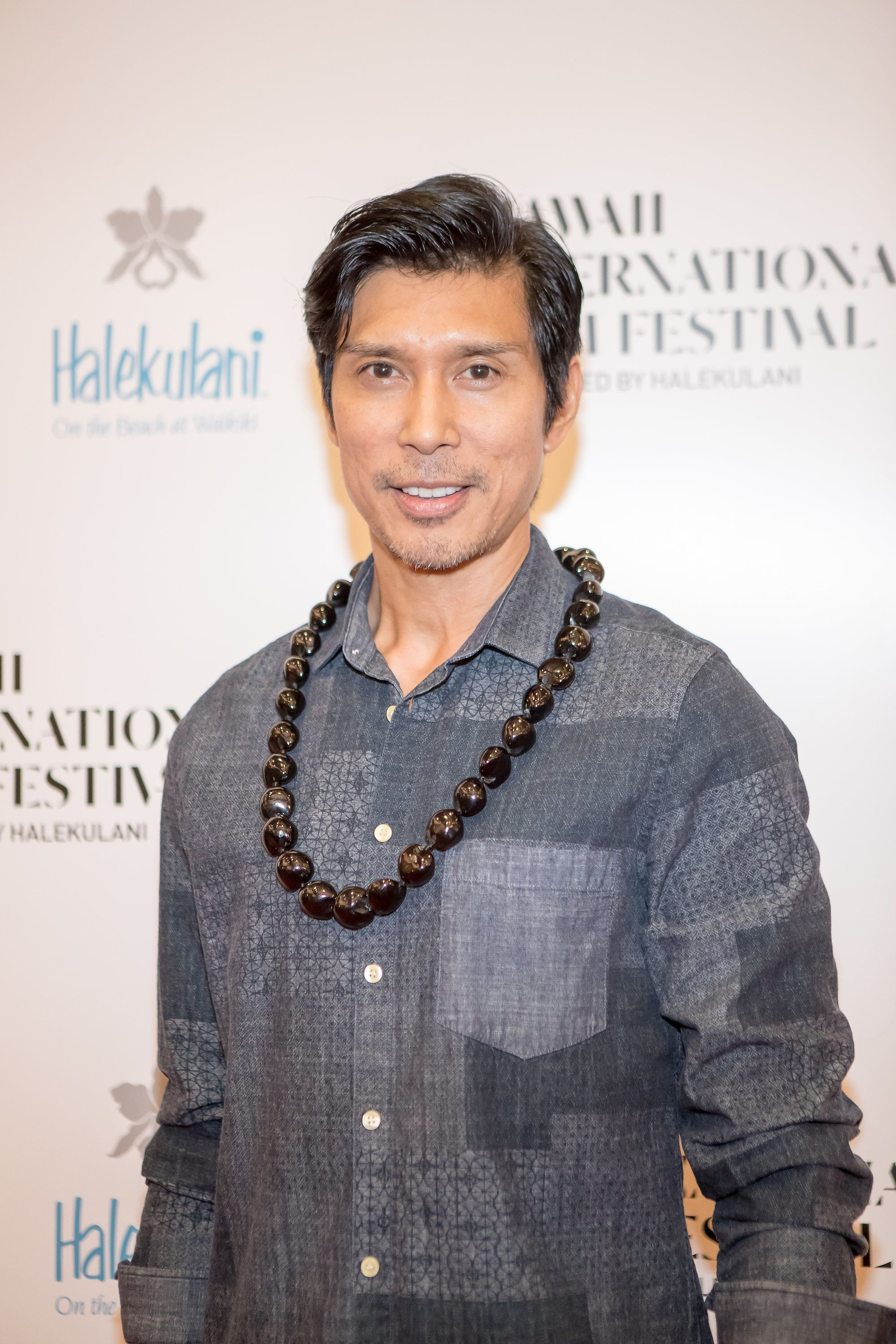 HONOLULU, HI - NOVEMBER 04: Director Keo Woolford arrives for the screening of his short film 'Song On Canvis' at the 2016 Hawaii International Film Festival at the Regal Dole Cannery Stadium 18 on November 4, 2016 in Honolulu, Hawaii. (Photo by Darryl Oumi/WireImage)