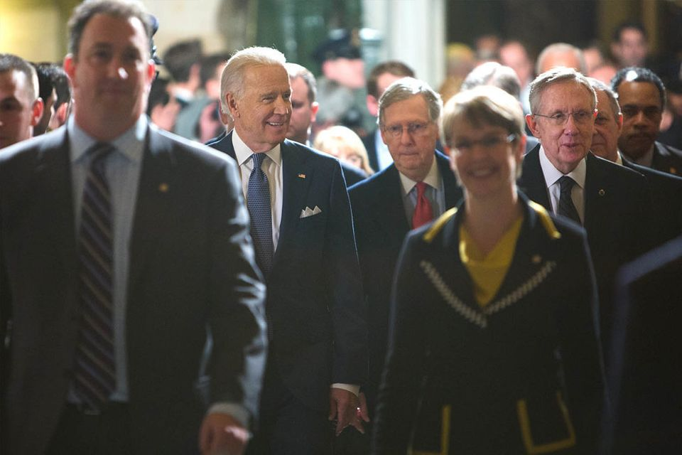 <strong>January 28, 2014</strong> Vice President Joe Biden walks from the Senate side to the House Side, with Senators Harry
