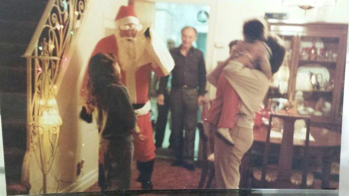 <p>Dad dressed as Santa, Christmas 1984</p>