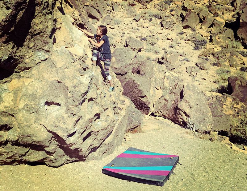 """Our 8 year old daughter working on one of her climbing """"projects."""""""