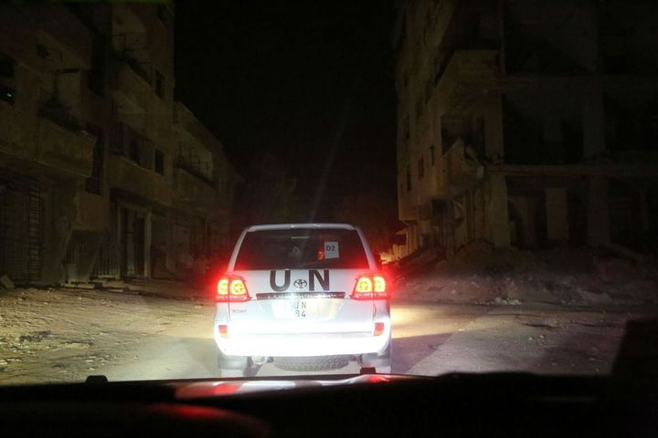 A convoy makes its way to deliver food to families in a besieged town..