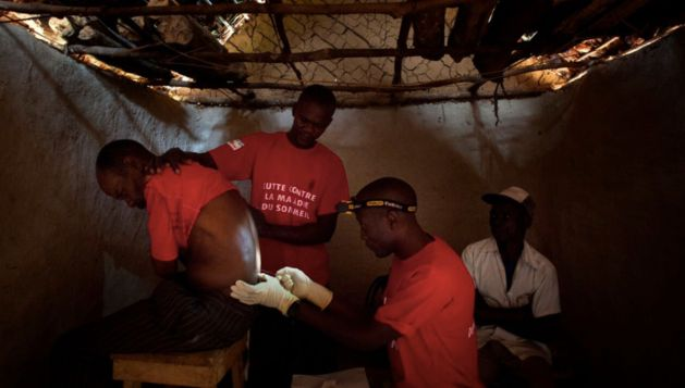 Doctors Without Borders staff perform a spinal tap to try to diagnose sleeping sickness, in the village of Basoloy, regi