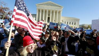 Immigrants and community leaders rally in front of the U.S. Supreme Court to mark the one-year anniversary of President Barack Obama's executive orders on immigration in Washington, November 20, 2015. The Obama administration on Friday asked the U.S. Supreme Court to revive President Barack Obama's executive action to protect millions of illegal immigrants from deportation, saying Republican-led states had no legal basis to challenge it. REUTERS/Kevin Lamarque