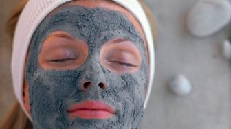 Woman resting with face mask and headband
