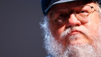 """George R.R. Martin, author of the """"Song of Ice and Fire"""" fantasy series that is the basis of the television series """"Game of Thrones"""", pauses during his masterclass at the Neuchatel International Fantastic Film Festival (NIFFF) in Neuchatel July 10, 2014. REUTERS/Denis Balibouse (SWITZERLAND - Tags: ENTERTAINMENT SOCIETY MEDIA HEADSHOT)"""