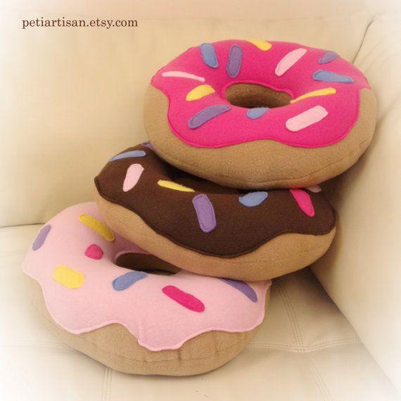 "$25.00, Etsy. Buy them <a href=""https://www.etsy.com/listing/239435682/doughnut-pillow-donut-pillow-food-pillow?ga_order=most"