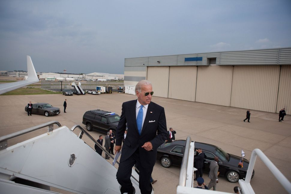 Welcome aboard: Vice President Joe Biden jogs up the stairs to Air Force Two at Lambert St. Louis International Airport, in S
