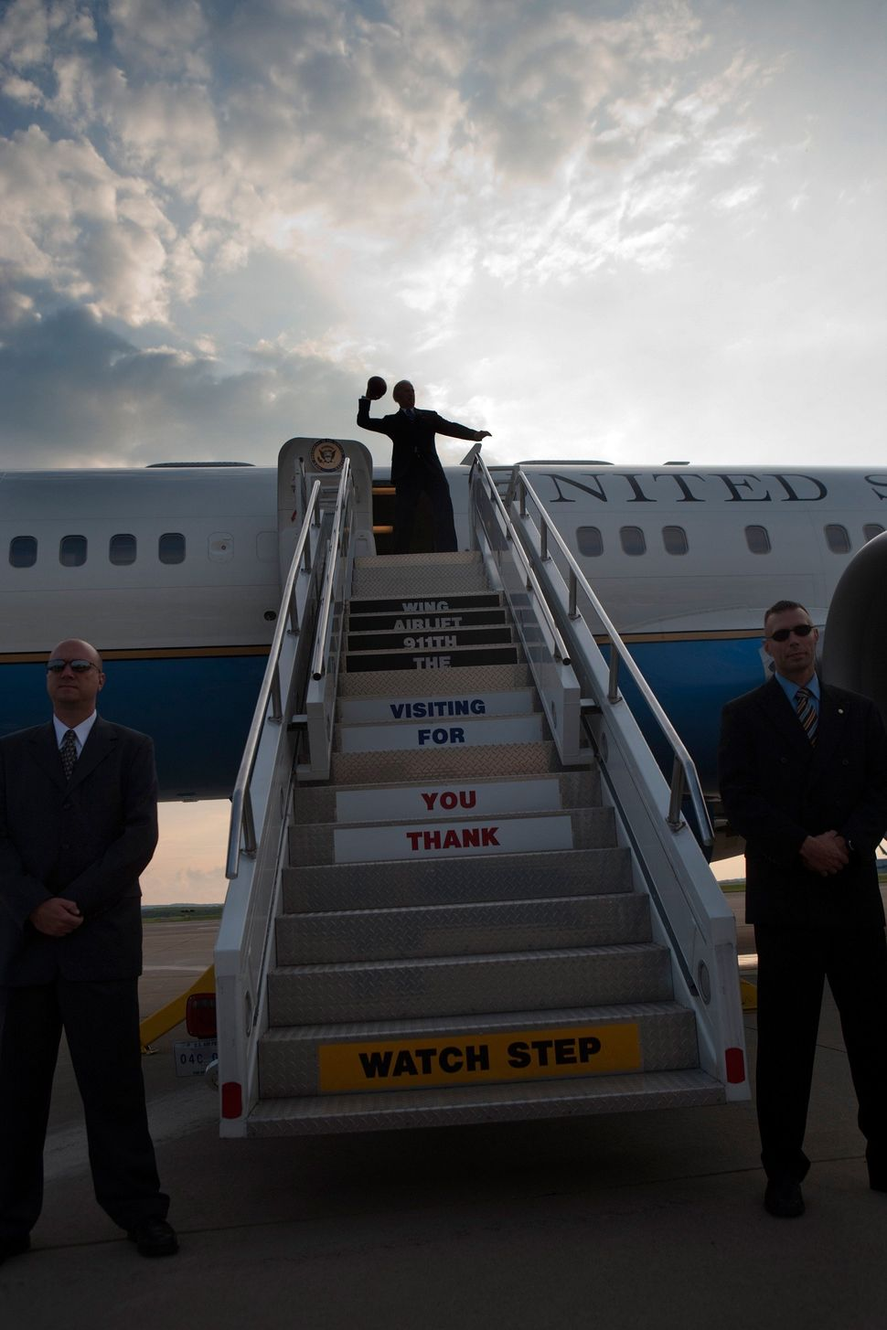 Vice President Joe Biden throws a football from the top of the stairs before boarding Air Force Two at Pittsburgh Internation