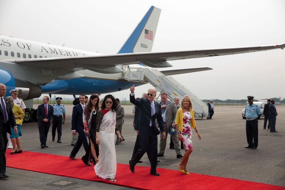 Vice President Joe Biden and Dr. Jill Biden wave as they arrive at Indira Gandhi International Airport, in New Delhi, India.