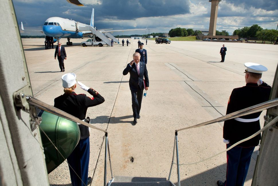 Vice President Joe Biden salutes as he approaches Marine Two after landing at Joint Base Andrews aboard Air Force Two. June 6