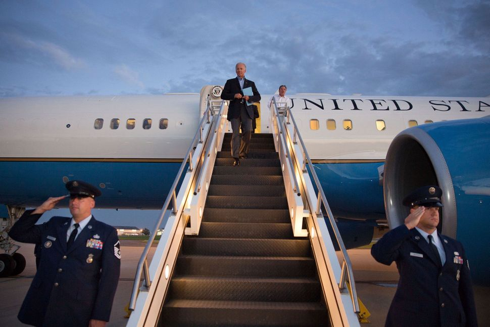 Vice President Joe Biden walks down the stairs of Air Force Two at New Castle County Airport. Wilmington, Delaware, Aug. 23,&