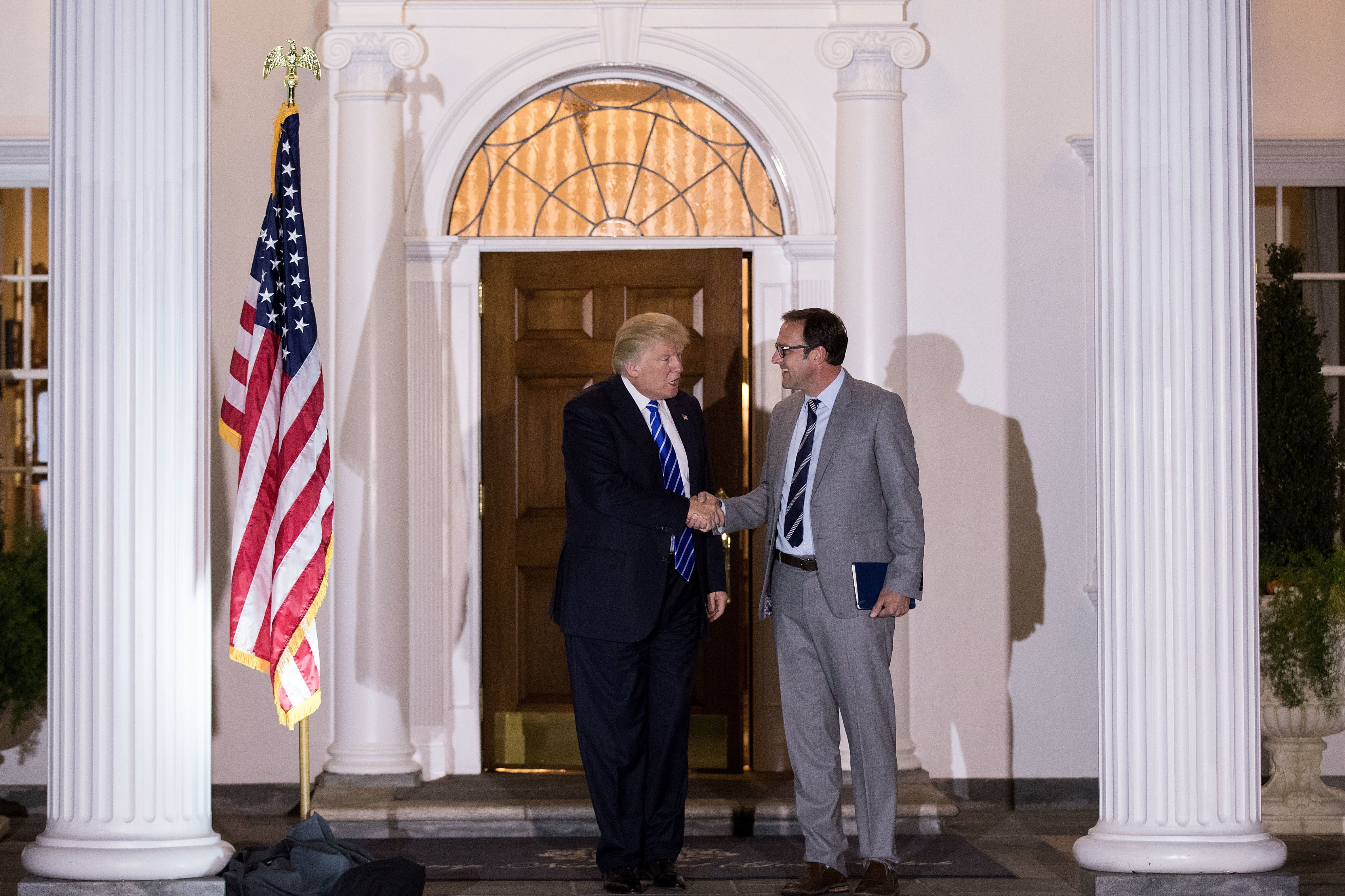 President-elect Donald Trump shakes hands with Todd Ricketts, co-owner of the Chicago Cubs, after their meeting at Trump Inte