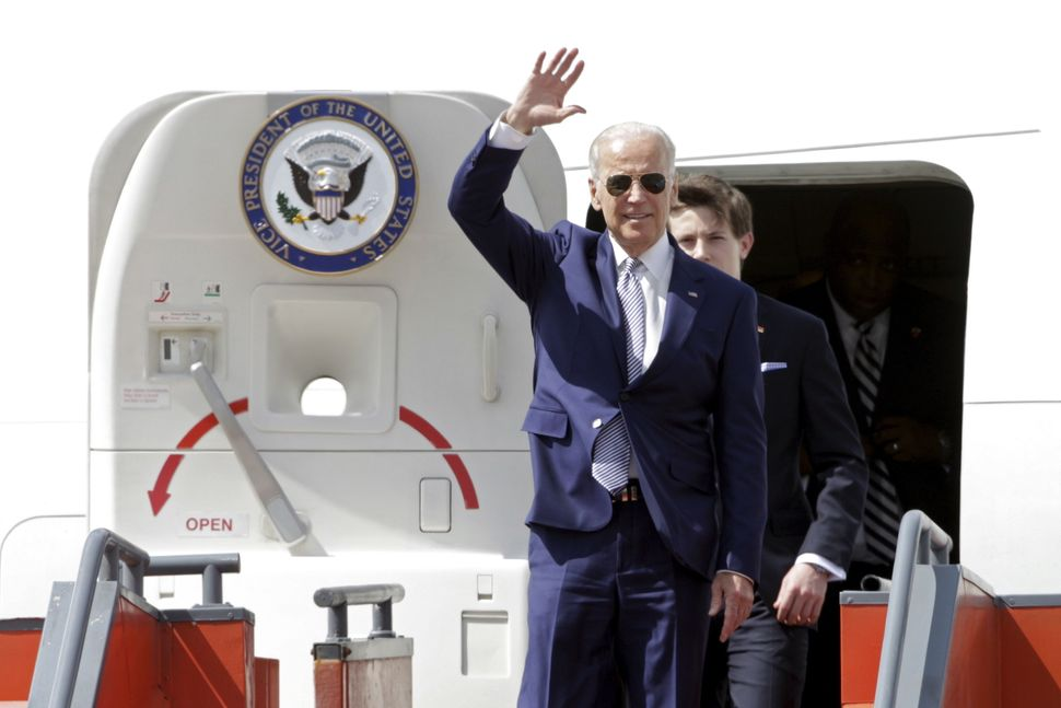 U.S. Vice President Joe Biden waves as he walks out of the plane upon his arrival for the inauguration of Guatemala's Preside